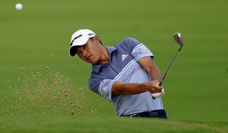 Collin Morikawa chips onto the 10th green during the first round of the Sony Open PGA Tour golf event, Thursday, Jan. 9, 2020, at Waialae Country Club in Honolulu. (AP Photo/Matt York)