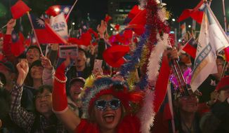 Supporters of Han Kuo-yu, Taiwan's 2020 presidential election candidate for the KMT or Nationalist Party, attend a campaign rally in Taipei, Taiwan, Thursday, Jan. 9, 2020. Taiwan will hold its presidential election on Jan. 11. (AP Photo/Ng Han Guan)