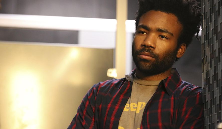 """In this image released by FX, Donald Glover portrays Earnest Marks in the comedy """"Atlanta."""" The series is returning with new episodes, but not for another year. FX Networks Chairman John Landgraf said Thursday, Jan. 9, 2020 that Glover, the star and creator, is making a total of 18 new episodes. Ten of them will air in January 2021, with the rest to follow later that year, in the fall. (Quantrell D. Colbert/FX via AP)"""