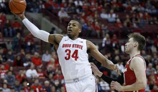 Ohio State forward Kaleb Wesson, left, grabs a rebound in front of Wisconsin forward Micah Potter during the first half of an NCAA college basketball game in Columbus, Ohio, Friday, Jan. 3, 2020. (AP Photo/Paul Vernon)