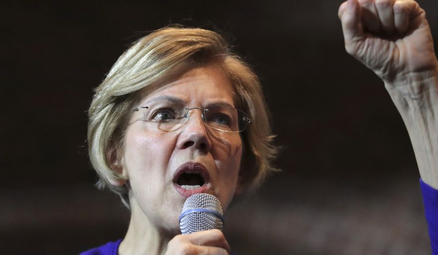 Democratic presidential candidate Sen. Elizabeth Warren, D-Mass., gestures during a campaign stop in Dover, N.H., Friday, Jan. 10, 2020. (AP Photo/Charles Krupa)