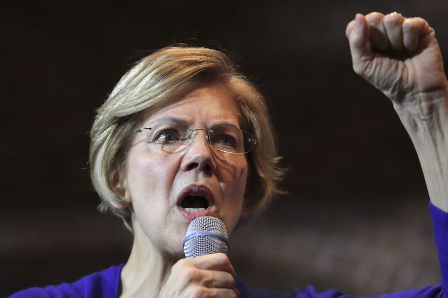 Democratic presidential candidate Sen. Elizabeth Warren, D-Mass., gestures during a campaign stop in Dover, N.H., Friday, Jan. 10, 2020. (AP Photo/Charles Krupa)