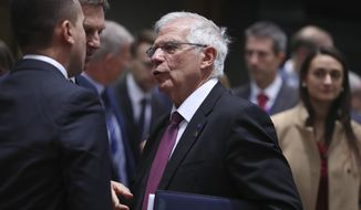 European Union foreign policy chief Josep Borrell, center, speaks with Italian Foreign Minister Luigi Di Maio, left, during a meeting of EU foreign ministers at the Europa building in Brussels, Friday, Jan. 10, 2020. EU foreign ministers and NATO Secretary General Jens Stoltenberg are gathering in Brussels for an emergency meeting during which they are expected to reiterate their support for the nuclear deal brokered with Iran. (AP Photo/Francisco Seco)