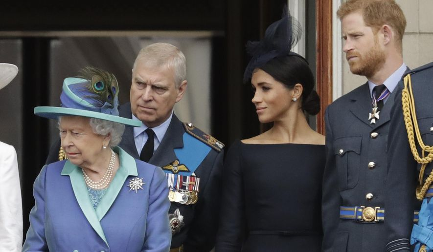"""FILE - In this Tuesday, July 10, 2018 file photo Britain's Queen Elizabeth II, Prince Andrew, Meghan the Duchess of Sussex and Prince Harry stand on a balcony to watch a flypast of Royal Air Force aircraft pass over Buckingham Palace in London. As part of a surprise announcement distancing themselves from the British royal family, Prince Harry and his wife Meghan declared they will """"work to become financially independent"""" _ a move that has not been clearly spelled out and could be fraught with obstacles. (AP Photo/Matt Dunham, File)"""