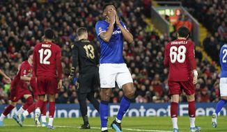 Everton's Cenk Tosun reacts after missing a scoring chance during the English FA Cup third round soccer match between Liverpool and Everton at Anfield stadium in Liverpool, England, Sunday, Jan. 5, 2020. (AP Photo/Jon Super)