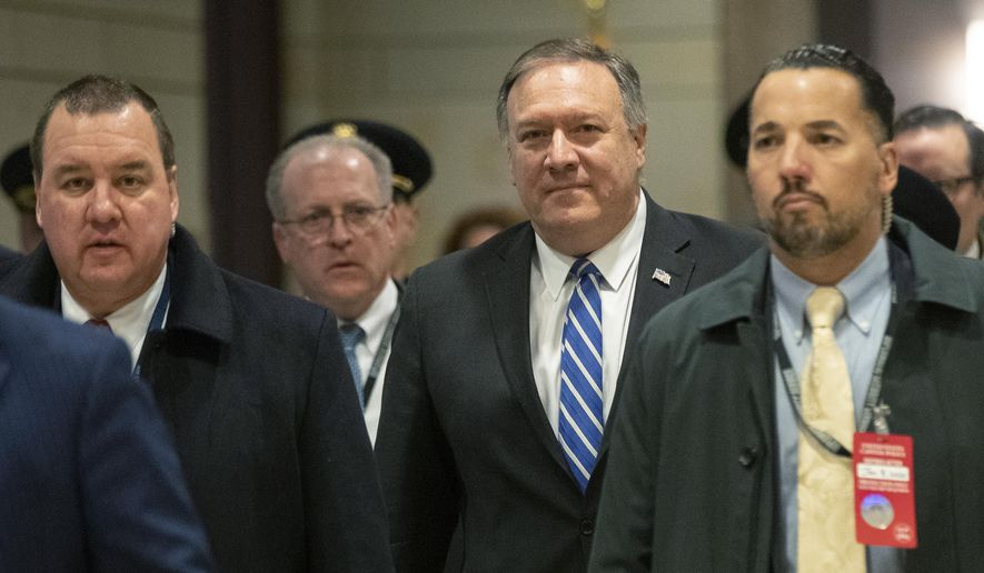 Secretary of State Mike Pompeo, walks toward the Senate after briefing members of Congress on last week's targeted killing of Iran's senior military commander Gen. Qassem Soleimani, Wednesday, Jan. 8, 2020, on Capitol Hill in Washington. (AP Photo/Manuel Balce Ceneta)