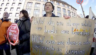 Activist of 'Extinction Rebellion' and 'Parents for Future Berlin' attend a protest rally against the climate policy of Australia's government in front of Australia's embassy in Berlin, Germany, Friday, Jan. 10, 2020. (AP Photo/Michael Sohn)