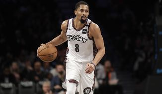 Brooklyn Nets' Spencer Dinwiddie (8) looks to pass during the second half of an NBA basketball game against the Miami Heat on Friday, Jan. 10, 2020, in New York. The Nets won 117-113. (AP Photo/Frank Franklin II)