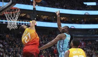 Utah Jazz center Rudy Gobert (27) blocks the shot of Charlotte Hornets center Bismack Biyombo (8) during the first quarter of an NBA basketball game Friday, Jan. 10, 2020, in Salt Lake City. (AP Photo/Chris Nicoll)