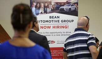 In this Sept. 18, 2019, file photo people stand in line to inquire about jobs available at the Bean Automotive Group during a job fair in Miami. On Friday, Jan. 10, 2020, the U.S. government issues the December jobs report. (AP Photo/Lynne Sladky, File)