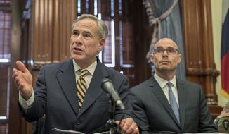 In this June 21, 2019, photo, Gov. Greg Abbott (left) speaks at a news conference at the Capitol, in Austin, Texas. (Jay Janner/Austin American-Statesman via AP) ** FILE **