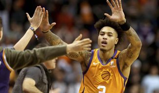 Phoenix Suns' Kelly Oubre Jr. (3) celebrate with fans after coming back late in an NBA basketball game against the Orlando Magic during the second half Friday, Jan. 10, 2020, in Phoenix. (AP Photo/Darryl Webb)