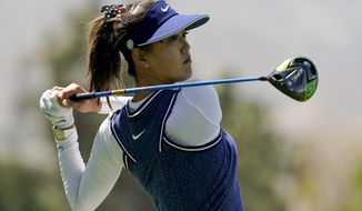 FILE - In this April 5, 2019, file photo, Michelle Wie watches her tee shot on the 118th hole during the second round of the LPGA Tour ANA Inspiration golf tournament at Mission Hills Country Club in Rancho Mirage, Calif. Wie is expecting her first child — a girl — this summer. The often-injured golfer announced the news Thursday, Jan. 9, 2020, on Instagram. She married Jonnie West, the son of NBA great Jerry West, in August. (AP Photo/Chris Carlson, File)