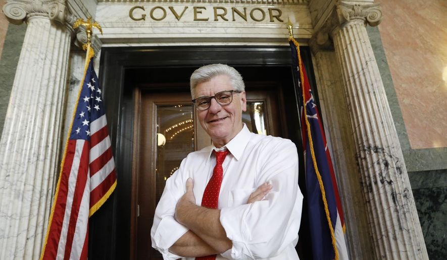 Gov. Phil Bryant stands outside his Capitol office in Jackson, Miss., Jan. 8, 2020. With much of his adult life devoted to public service, Bryant leaves a strong legacy. Gov.-elect Tate Reeves will be sworn into office at noon Tuesday, Jan. 14. (AP Photo/Rogelio V. Solis)