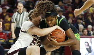 Arizona State center Jamie Ruden (52) and Oregon forward Ruthy Hebard compete for possession of the ball during the first half of an NCAA college basketball game Friday, Jan. 10, 2020, in Tempe, Ariz. (AP Photo/Ralph Freso)