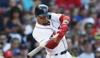 In this Aug. 10, 2019, file photo, Boston Red Sox's Mookie Betts hits an RBI-double during the sixth inning of a baseball game against the Los Angeles Angels in Boston. Betts has agreed to a $27 million contract with the Red Sox. It is the largest one-year salary for an arbitration-eligible player.  (AP Photo/Michael Dwyer, File)  **FILE**