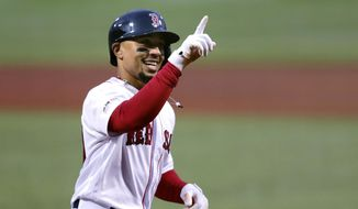 FILE - In this April 30, 2019, file photo, Boston Red Sox's Mookie Betts smiles as he crosses home plate on his solo home run off Oakland Athletics starting pitcher Aaron Brooks in the first inning of a baseball game at Fenway Park in Boston. . (AP Photo/Charles Krupa, File)  **FILE**