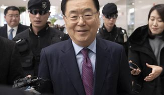 Chung Eui-yong, South Korea's presidential national security director, speaks to the media after returning from Washington at the Incheon International Airport, South Korea, Friday, Jan. 10, 2020. South Korea said Friday it conveyed a message by President Donald Trump to North Korean leader Kim Jong Un wishing him a happy birthday, which is believed to be Jan. 8. (Yun Dong-jin/Yonhap via AP)