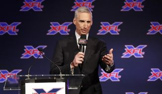 In this Feb. 7, 2019, file photo, Oliver Luck, XFL Commissioner and CEO, makes comments during a news conference in Arlington, Texas, Thursday, Feb. 7, 2019. (AP Photo/Tony Gutierrez) ** FILE **