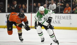 Anaheim Ducks right wing Daniel Sprong, left, reaches for Dallas Stars defenseman Roman Polak as Polak takes the puck during the first period of an NHL hockey game Thursday, Jan. 9, 2020, in Anaheim, Calif. (AP Photo/Mark J. Terrill)