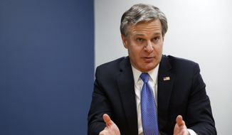 In this Dec. 9, 2019, file photo, FBI Director Christopher Wray speaks during an interview with The Associated Press in Washington. (AP Photo/Jacquelyn Martin, File)
