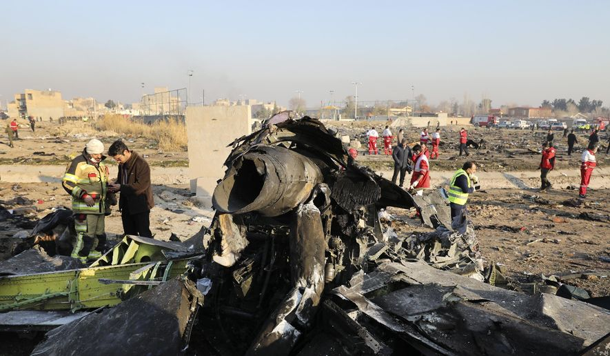 In this Wednesday, Jan. 8, 2020, file photo, debris at the scene where a Ukrainian plane crashed in Shahedshahr southwest of the capital Tehran, Iran. (AP Photo/Ebrahim Noroozi, File)