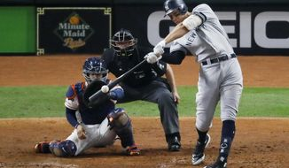 FILE - In this Oct. 13, 2019, file photo, New York Yankees' Aaron Judge hits a two-run home run against the Houston Astros during the fourth inning in Game 2 of baseball's American League Championship Series in Houston. Judge agreed to an $8.5 million, one-year contract Friday, Jan. 10, 2020, with the Yankees. (AP Photo/Sue Ogrocki, File)