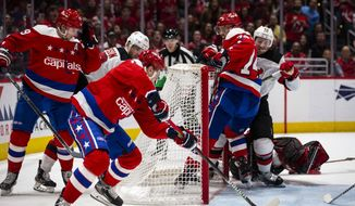 Washington Capitals left wing Jakub Vrana (13), from the Czech Republic, shoots for a goal during the second period against the New Jersey Devils in an NHL hockey game Saturday, Jan. 11, 2020, in Washington. (AP Photo/Al Drago) ** FILE **