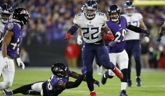 Tennessee Titans running back Derrick Henry (22) runs past Baltimore Ravens players during the second half of an NFL divisional playoff football game, Saturday, Jan. 11, 2020, in Baltimore. (AP Photo/Julio Cortez)