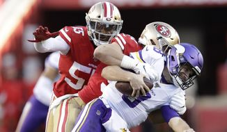 Minnesota Vikings quarterback Kirk Cousins, foreground, is tackled by San Francisco 49ers defensive end Nick Bosa, center, during the second half of an NFL divisional playoff football game, Saturday, Jan. 11, 2020, in Santa Clara, Calif. Also pictured at rear is defensive end Dee Ford. (AP Photo/Ben Margot)  **FILE**
