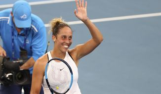 Madison Keys of the United States waves to the crowd after winning her semifinal match against Petra Kvitova of the Czech Republic 3-6, 6-2, 6-3, at the Brisbane International tennis tournament in Brisbane, Australia, Saturday, Jan. 11, 2020. (AP Photo/Tertius Pickard)