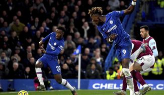 Chelsea's Callum Hudson-Odoi, left, on his way to score his team's third goal ,  during the English Premier League soccer match between Chelsea and Burnley at Stamford Bridge, in London, Saturday, Jan. 11, 2020. (Victoria Jones/PA via AP)