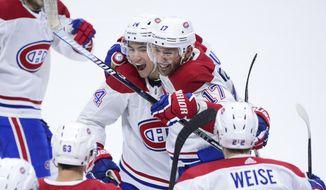 Montreal Canadiens' Ilya Kovalchuk (17) and teammate Nick Suzuki (14) celebrate the team's 2-1 win over the Ottawa Senators in an NHL hockey game Saturday, Jan. 11, 2020, in Ottawa, Ontario. (Sean Kilpatrick/The Canadian Press via AP)