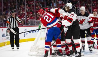 New Jersey Devils right wing Wayne Simmonds (17) scuffles with Washington Capitals right wing Garnet Hathaway (21) during the second period of an NHL hockey game Saturday, Jan. 11, 2020, in Washington. (AP Photo/Al Drago)