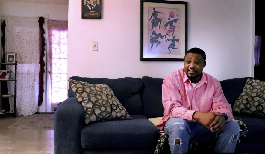 Marques Martin talks in his home in Murfreesboro, Tenn., on Thursday, Dec. 12, 2019, about how he continued to get arrested from 2001-2018 for not paying probation fines. (Helen Comer/The Daily News Journal via AP)