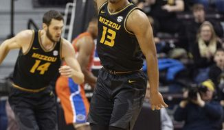 Missouri's Mark Smith celebrates a three point shot during the first half of an NCAA college basketball game against Florida Saturday, Jan. 11, 2020, in Columbia, Mo. (AP Photo/L.G. Patterson)
