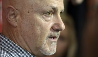 "Washington Nationals general manager Mike Rizzo talks with members of the media during the team's ""Winterfest"" baseball fan festival, Saturday, Jan. 11, 2020, in Washington. (AP Photo/Sait Serkan Gurbuz)"