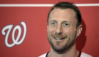 Washington Nationals pitcher Max Scherzer talks with members of the media during the team's 'Winterfest' baseball fan festival, Saturday, Jan. 11, 2020 in Washington. (AP Photo/Sait Serkan Gurbuz) ** FILE **