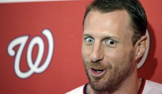 "Washington Nationals pitcher Max Scherzer talks with members of the media during the team's ""Winterfest"" baseball fan festival, Saturday, Jan. 11, 2020, in Washington. (AP Photo/Sait Serkan Gurbuz)"