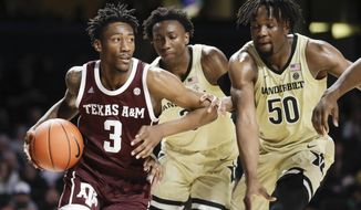Texas A&M guard Quenton Jackson (3) drives against Vanderbilt defenders Saben Lee, center, and Ejike Obinna (50) in the first half of an NCAA college basketball game Saturday, Jan. 11, 2020, in Nashville, Tenn. (AP Photo/Mark Humphrey)