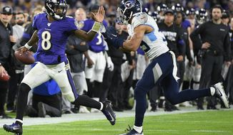 Baltimore Ravens quarterback Lamar Jackson (8) runs near Tennessee Titans linebacker Harold Landry (58) during the second half of an NFL divisional playoff football game, Saturday, Jan. 11, 2020, in Baltimore. (AP Photo/Nick Wass)