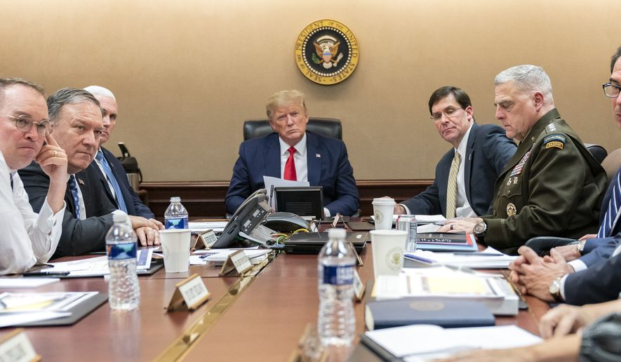 In this image released by the White House, President Donald Trump, joined by Vice President Mike Pence, meets with senior White House advisors Tuesday evening, Jan. 7, 2020, in the Situation Room of the White House in Washington.(Shealah Craighead/White House via AP)
