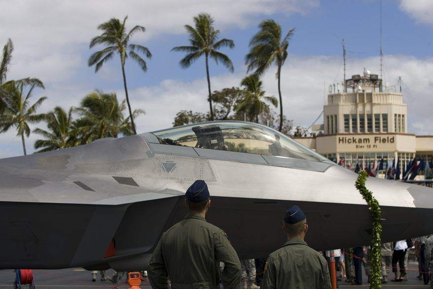 A F-22 Raptor is seen after a ceremony welcoming the jets at Joint Base Pearl Harbor-Hickham Friday, July 9, 2010, in Honolulu. The jets will be part of the Hawaii Air National Guard. (AP Photo/Marco Garcia)