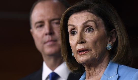 House Speaker Nancy Pelosi of Calif., right, joined by House Intelligence Committee Chairman Rep. Adam Schiff, D-Calif., left, speaks during a news conference on Capitol Hill in Washington, Wednesday, Oct. 2, 2019 (AP Photo/Susan Walsh)