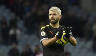 Manchester City's Sergio Aguero applauds to supporters at the end of the English Premier League soccer match between Aston Villa and Manchester City at Villa Park in Birmingham, England, Sunday, Jan. 12, 2020. Manchester City won the game 1-6. (AP Photo/Rui Vieira)