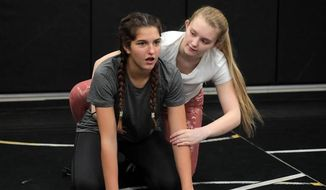 In this recent photo, 14-year-old Cyan Smith, left, and 17-year-old Samantha Neff attend wrestling practice at Rock Hill High School in Rock Hill, S.C. (Tracy Kimball/The Herald via AP)