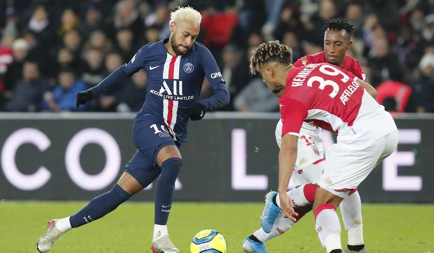 PSG's Neymar, left, is challenged by Monaco's Benjamin Henrichs during the French League One soccer match between Paris-Saint-Germain and Monaco at the Parc des Princes stadium in Paris, Sunday Jan. 12, 2020. (AP Photo/Francois Mori)