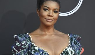 """FILE - In this July 10, 2019, file photo, Gabrielle Union arrives at the ESPY Awards at the Microsoft Theater in Los Angeles. An investigation of Union's complaints of racism and other troubling behavior on the set of """"America's Got Talent"""" is being taken very seriously by NBC, the network's entertainment chief said Saturday, Jan. 11, 2020. (Photo by Jordan Strauss/Invision/AP, File)"""