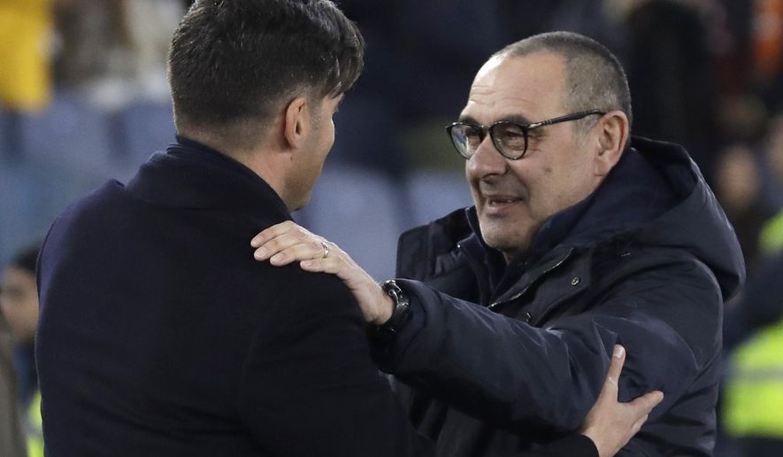 Roma's head coach Paulo Fonseca, left, and Juventus' coach Maurizio Sarri greet prior to the Serie A soccer match between Roma and Juventus at the Rome Olympic Stadium, Italy, Sunday, Jan. 12, 2020. (AP Photo/Andrew Medichini)