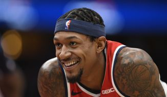 Washington Wizards guard Bradley Beal smiles during the second half of the team's NBA basketball game against the Orlando Magic, Wednesday, Jan. 1, 2020, in Washington. The Magic won 122-101. (AP Photo/Nick Wass)